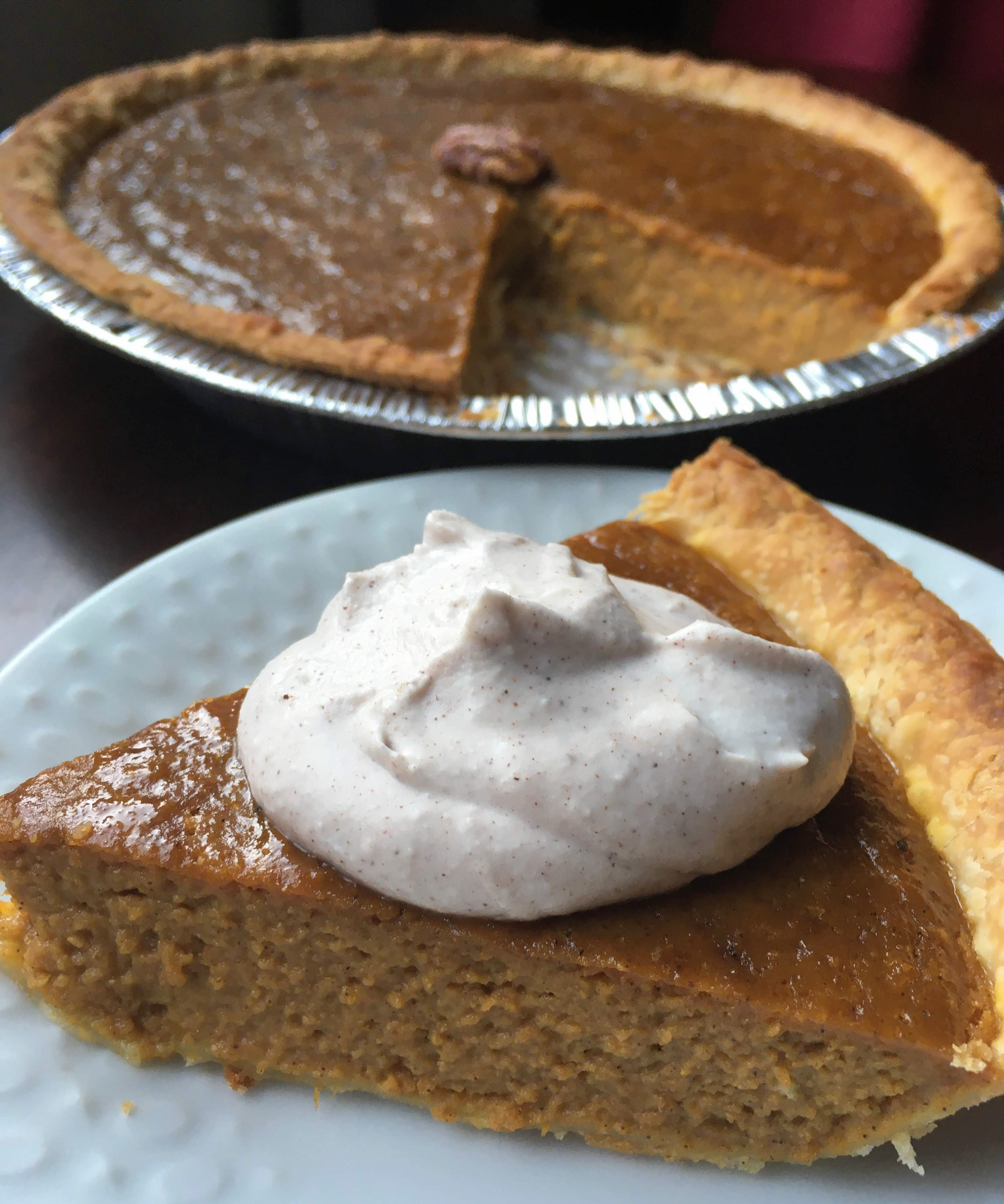 dairy free pumpkin pie made with coconut milk and topped with pumpkin spice coconut whip